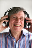 Music man. Smiling man listening to music with headphones stock images