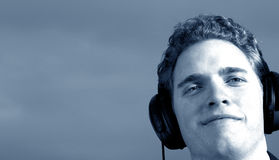 Music man is listening. Man listening with his headphones stock images