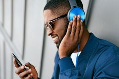 Free Music. Man With Phone Listening Music In Headphones Royalty Free Stock Image - 125160116