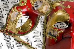 Music Mask 3. Two Venetian masks lay on top of an old score of music Royalty Free Stock Photography
