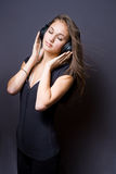 Music meditation. Artistic portrait of a beautiful young brunette girl immersed in music meditation Stock Photos