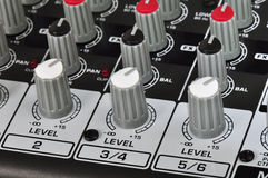 Music mixer. Knobs on a music mixer Royalty Free Stock Photo