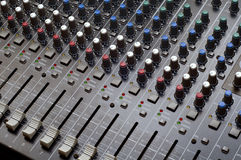 Music Mixer. Photo of a multi channel music mixer. All the levels are set to the lowest value Stock Image