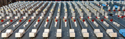 Music mixer. Multi channel music mixer commonly used in music studios, and radio stations Royalty Free Stock Images