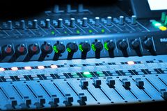 Music Mixer. Professional music mixer in blue light Royalty Free Stock Photography