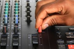 Music mixer. Image of a Music mixer with hand on the control Stock Image