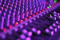 Music mixer in concert, filled with lights Stock Photo