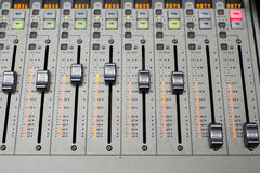 Music Mixer. Button close-up of professional digital mixer Royalty Free Stock Images