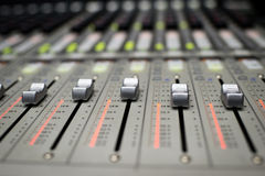 Music Mixer. Button close-up of professional digital mixer Royalty Free Stock Photography