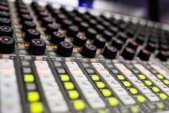 Music Mixer. Button close-up of professional digital mixer Stock Photos