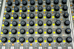 Music Mixer. Button close-up of professional digital mixer Stock Image