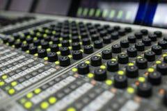 Music Mixer. Button close-up of professional digital mixer Royalty Free Stock Photo