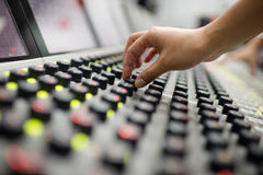 Music Mixer. Audio division is operating a digital mixer button stock illustration