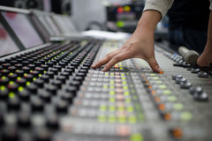 Music Mixer. Audio division is operating a digital mixer button Stock Image