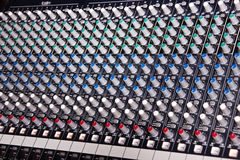 Music mixer amplifier. Music system mixer hundreds of buttons, rotating knobs, generic background for music themes Stock Photo