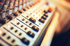 Music mixer button, setting volume. Music production mixer, adjustment tools. Close-up of music mixer button, setting volume. Music production mixer, adjustment Royalty Free Stock Photo