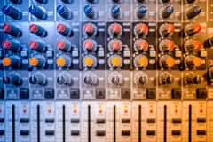 Music mixer at concert, close-up of buttons playing at electrical music festival and concert Royalty Free Stock Photo