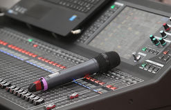 Music mixer control panel with microphone Stock Photo