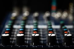 Music mixer desk. Detail of a music mixer desk with various knobs Stock Images