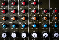 Music mixer desk. Detail of a music mixer desk with various knobs Royalty Free Stock Photo