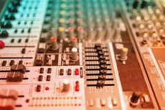 Music mixer and digital equalizer at concert or party in the night club Stock Photos