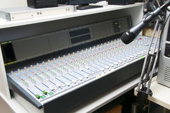 Music Mixer end studio microphone. Music Mixer desk table in radio studio. closeup footage Royalty Free Stock Image