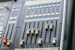 Music mixer equalizer console for mixer control sound device. Sound technician audio mixer equalizer control. Mastering Royalty Free Stock Photo