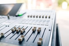 Music mixer equalizer console for mixer control sound device. Sound technician audio mixer equalizer control. Mastering Royalty Free Stock Photography