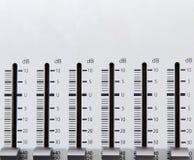 Music mixer faders. Closeup of the decibel switches of a music mixer royalty free stock photos