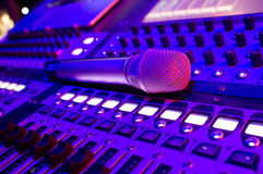 Music Mixer. A microphone placed a Beautiful close-up mixer push button under the lights Royalty Free Stock Image