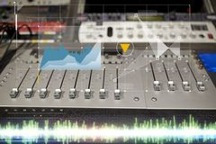 Music mixing console at sound recording studio. Music, technology, electronics and equipment concept - mixing console at sound recording studio Royalty Free Stock Photos