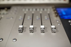 Music mixing console at sound recording studio Stock Images