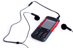 Music mobile phone with headphones. Photo of isolated on white music mobile phone with  headphones Royalty Free Stock Photography