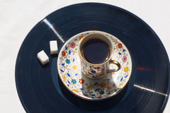 Music morning, vinyl plate and coffee with sugar. Royalty Free Stock Photography