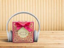 Music. Christmas gift birthday headphones listening sound Stock Images