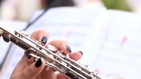 Music. Musician playing on flute stock video footage