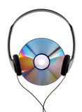 Music in my head!. A colorful CD with headphones listening to music Royalty Free Stock Image