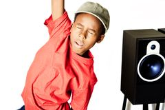 Music in my head boy. A boy gets excited over a little music Royalty Free Stock Photo