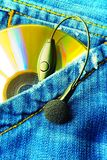 Music In My Pocket. (Disc & Earphone In A Jeans Pocket Stock Photos