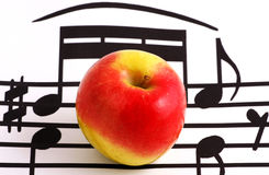 Music notation elements and apple Royalty Free Stock Photo