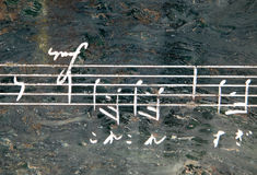 Music notation on stone Stock Image
