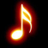 Music note. Glowing music note on a dark background Stock Images