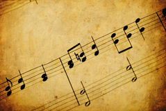 Music note. On old paper royalty free stock photos