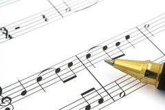 Music note. Close-up of music note and ballpoint pen tip stock images