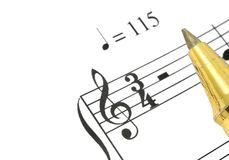 Music note. Extreme close-up of music note and ballpoint pen tip against white background, focus is set on treble clef Stock Photo