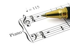 Music note #3. Close-up of music note and ballpoint pen tip Royalty Free Stock Image