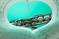 Music Note Book and Silver Soprano Flute Close Up Photography Stock Images