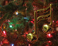 Music Note Christmas Ornament. A music note Christmas ornament hanging in a Christmas tree royalty free stock photo
