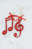 Music note,Christmass background. Picture of a music note on a snow ,Christmass background royalty free stock photos
