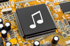 Music note on computer chip. Technology concept stock image